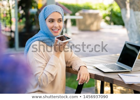 счастливая девушка хиджабе голосом сообщение смартфон парка Сток-фото © pressmaster
