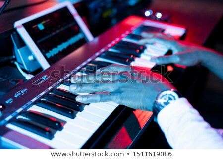 Hands of young contemporary musician over keys of pianoboard during making music Stock photo © pressmaster