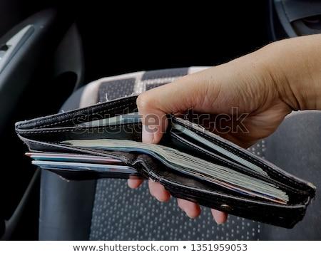 Noir portefeuille à l'intérieur voiture cuir Photo stock © AndreyPopov