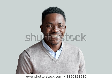Stylish guy of African ethnicity in smart casual standing in front of camera Stock photo © pressmaster