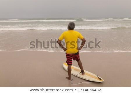 Hátsó nézet idős férfi szörfös kéz csípő Stock fotó © wavebreak_media