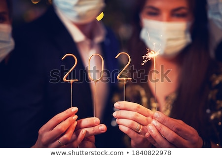 Foto stock: Party People Women And Men Celebrating New Years Eve 2020