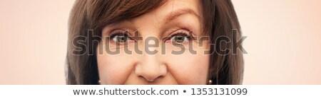 Yarım yüz kıdemli kadın bej güzellik Stok fotoğraf © dolgachov