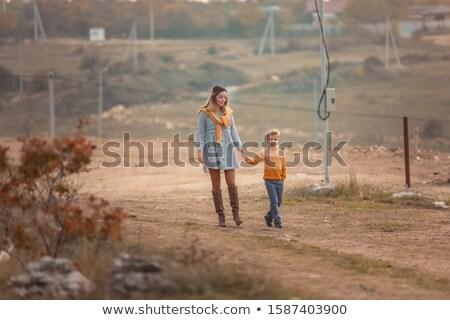 Kadın anne çocuk yıl eski yürümek Stok fotoğraf © ElenaBatkova