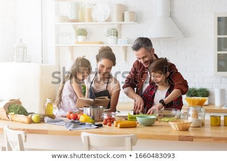 Gıda aile akşam yemeği dengeli beslenme pişirme mutfak Stok fotoğraf © choreograph