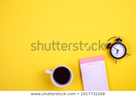 Office workplace with supplies and alarm clock Stock photo © karandaev