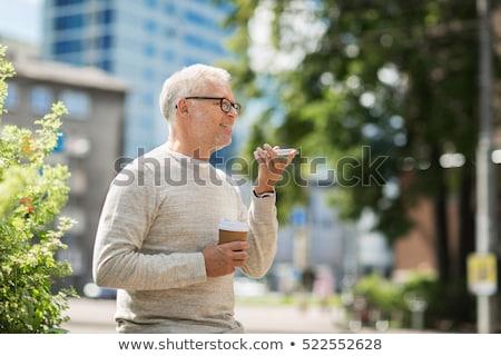 Idős férfi hang parancs furulya okostelefon technológia Stock fotó © dolgachov