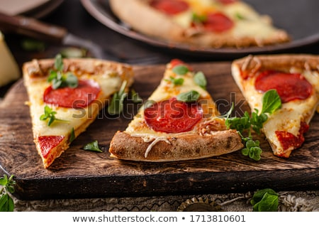 Homemade salami pizza with cheese corners Stock photo © Peteer
