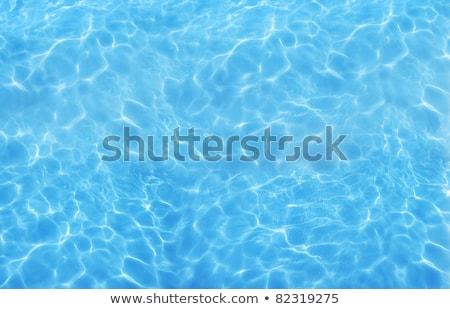 Azul mar superfície da água ondulação sol reflexões Foto stock © wildman