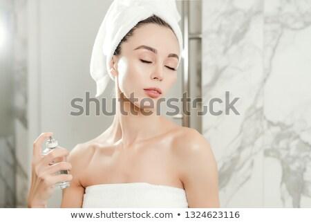 Gyönyörű nő tart parfüm illat vonzó fiatal nő Stock fotó © lovleah