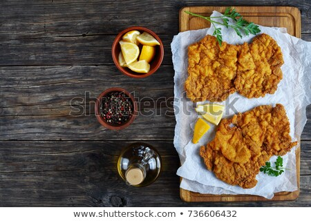 lemon wedge and parsley on a cutting board stock photo © 808isgreat