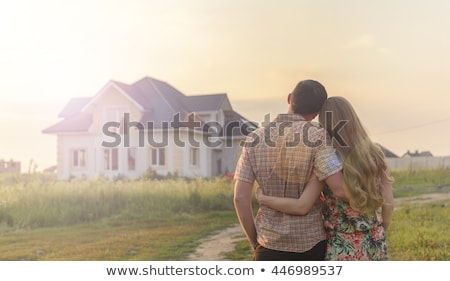 Young couple in front of apartments Stock photo © photography33