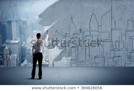 businessman holding a roller and wallpapers stock photo © photography33