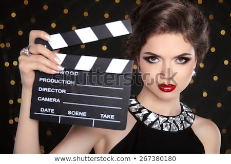 brunette woman with a cinema clap stock photo © photography33