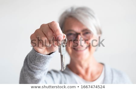 Happy female holding keys of her new apartment Stock photo © photography33