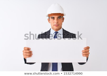 a pensive architect holding a poster stock photo © photography33
