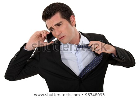 Man eager to end a telephone conversation Stock photo © photography33