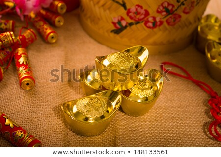 Dragon on large gold ingot Stock photo © calvste