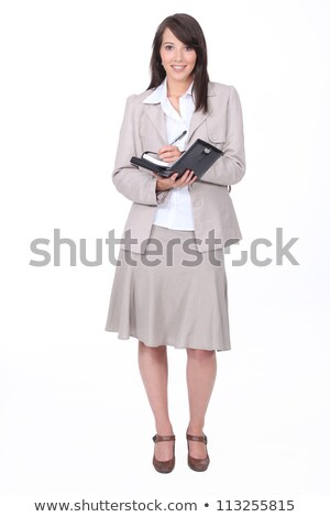 Young woman in a skirt suit writing in a personal organizer Stock photo © photography33