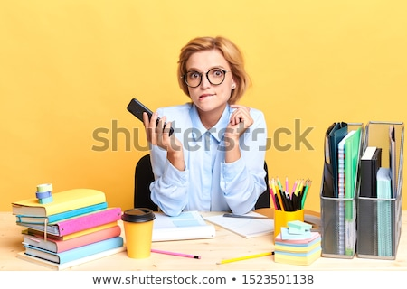 Female executive looking puzzled at her phone Stock photo © photography33
