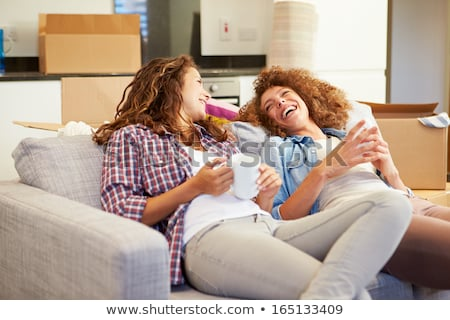 Two female friends moving house Stock photo © photography33