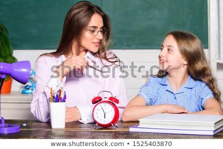 домашнее задание время девушки Дать спиральных ноутбук Сток-фото © stockyimages