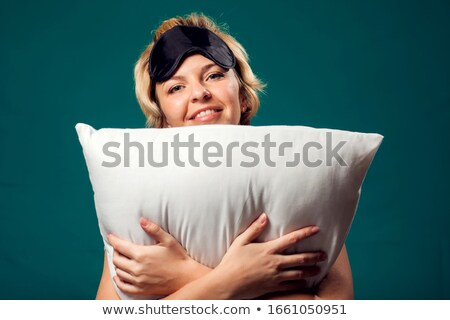 happy blond with black pillow Stock photo © dolgachov