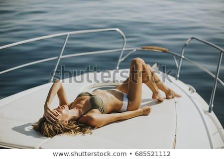 солнечные · ванны · роскошь · лодка · чтение · книга - Сток-фото © CandyboxPhoto