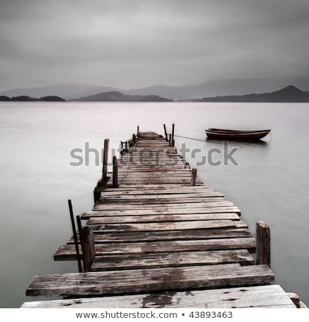Desolated wooden pier in low saturation Stock photo © kawing921