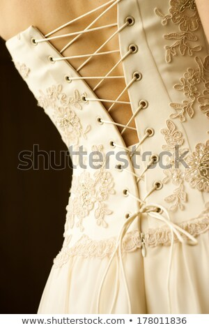 Lacing on a corset - rear view Stock photo © pzaxe