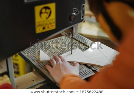 Woman holding band saw Stock photo © photography33