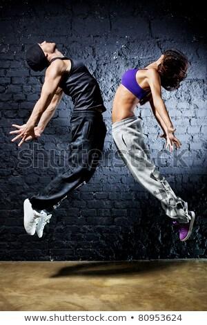 девушки хип-хоп танцовщицы Flying женщину современных Сток-фото © carlodapino