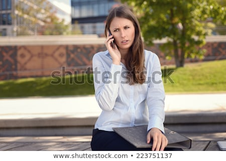 Exasperated woman talking on her mobile phone Stock photo © photography33