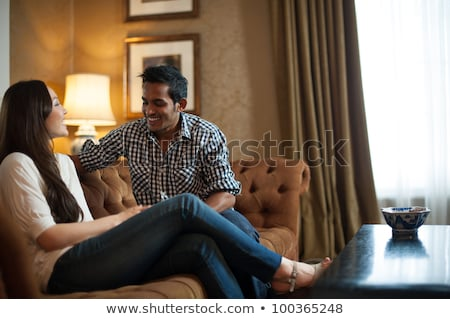 interracial couple relaxing in lounge Stock photo © photography33