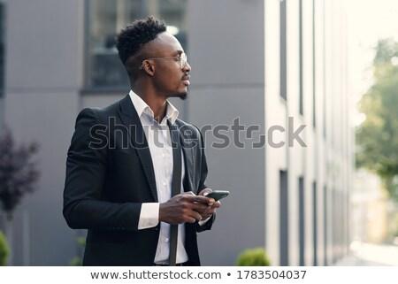 Portré afroamerikai üzletember sms üzenetküldés üzlet férfi Stock fotó © dacasdo