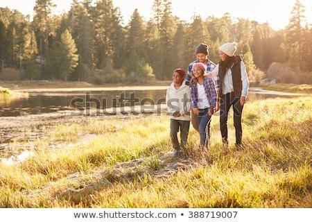 Stockfoto: Familie · vier · meer · hemel · hand · baby