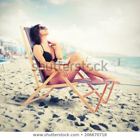 beautiful woman in bikini resting on the beach at sunset summ stock photo © victoria_andreas