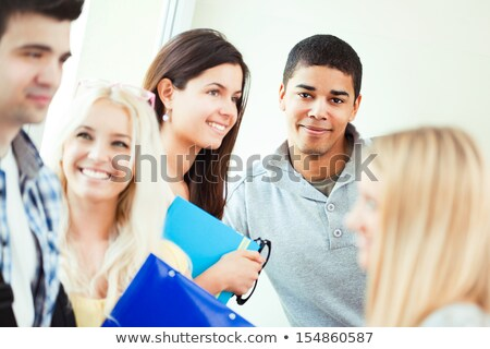 Portrait of a smiling African college student surrounded by his peers. Stock photo © luminastock
