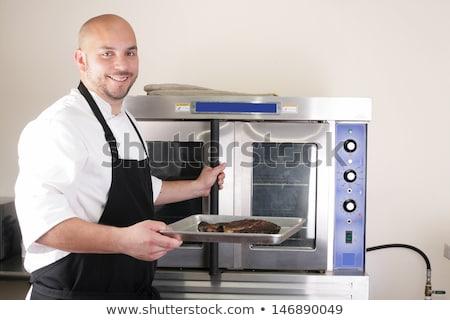 Happy chef taking his freshly baked rib-eye steak Stock photo © dacasdo