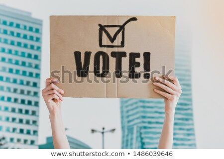Man holding cardboard paper with word Yes Stock photo © stevanovicigor