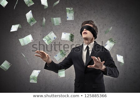 Businessman try to catch flying money in the air Stock photo © ratch0013
