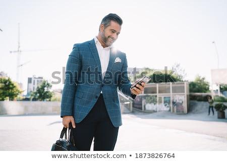 улыбаясь бизнесмен поиск баланса бизнеса Сток-фото © jaycriss