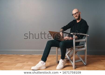 bearded man sits in the studio stock photo © feedough