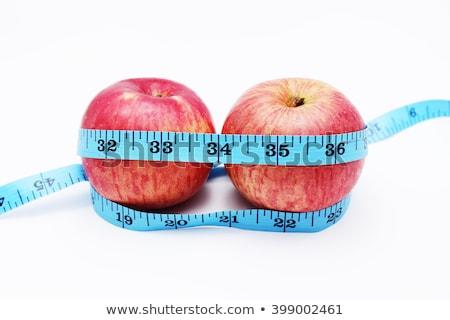 Сток-фото: рулетка · вокруг · плодов · изолированный · белый · яблоко