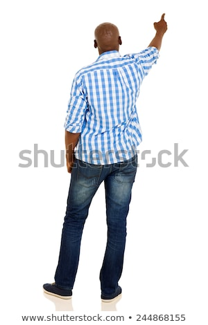 Rear view of african guy in casuals Stock photo © stockyimages