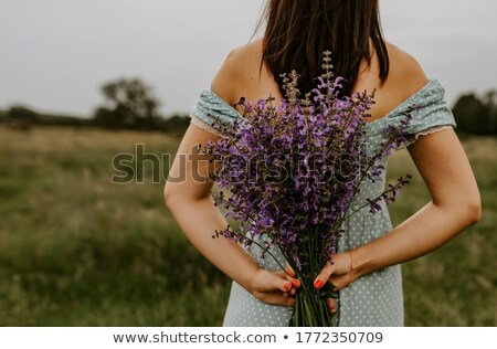 young beautiful girl in yellow dress holding lilac bouquet stock photo © nejron
