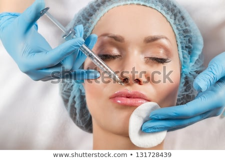 Beautiful female lips plastic surgery, her lips at the needle Stock photo © Geribody