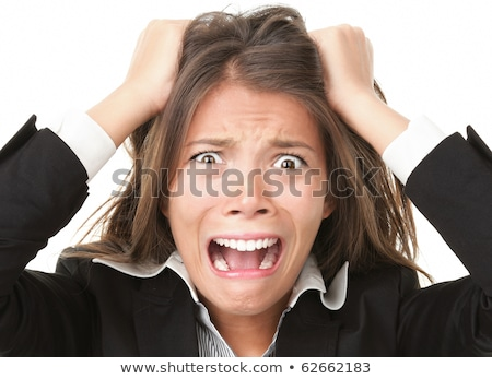 young woman looking frustrated and pulling her hair stock photo © bmonteny