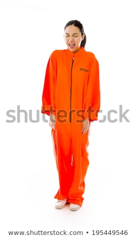 Stock foto: Young Asian Woman Shouting In Excitement And Wearing Prisoners Uniform