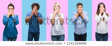 Shocked Asian woman with hand over mouth isolated on colored background Stock photo © bmonteny